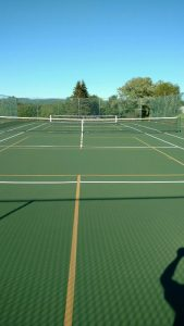 Newly resurfaced court with 2 Pickle Ball lines; color: Deco Forest Green.
