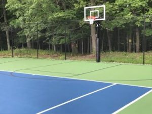 Newly resurfaced tennis/basketball court Deco; colors: US Open Blue and US Open green, lines are Deco white tennis, Deco black basketball, the hoop is a First Team Champ Select.